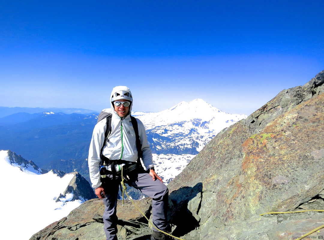 Climbing Mt. Shuksan's Summit Pyramid with Mt. Baker in the distance