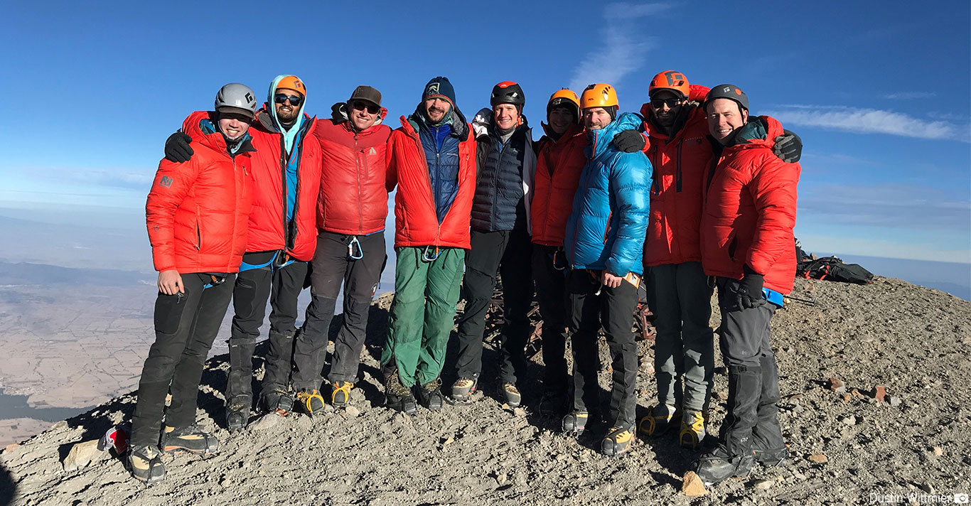 A team on the summit of Orizaba