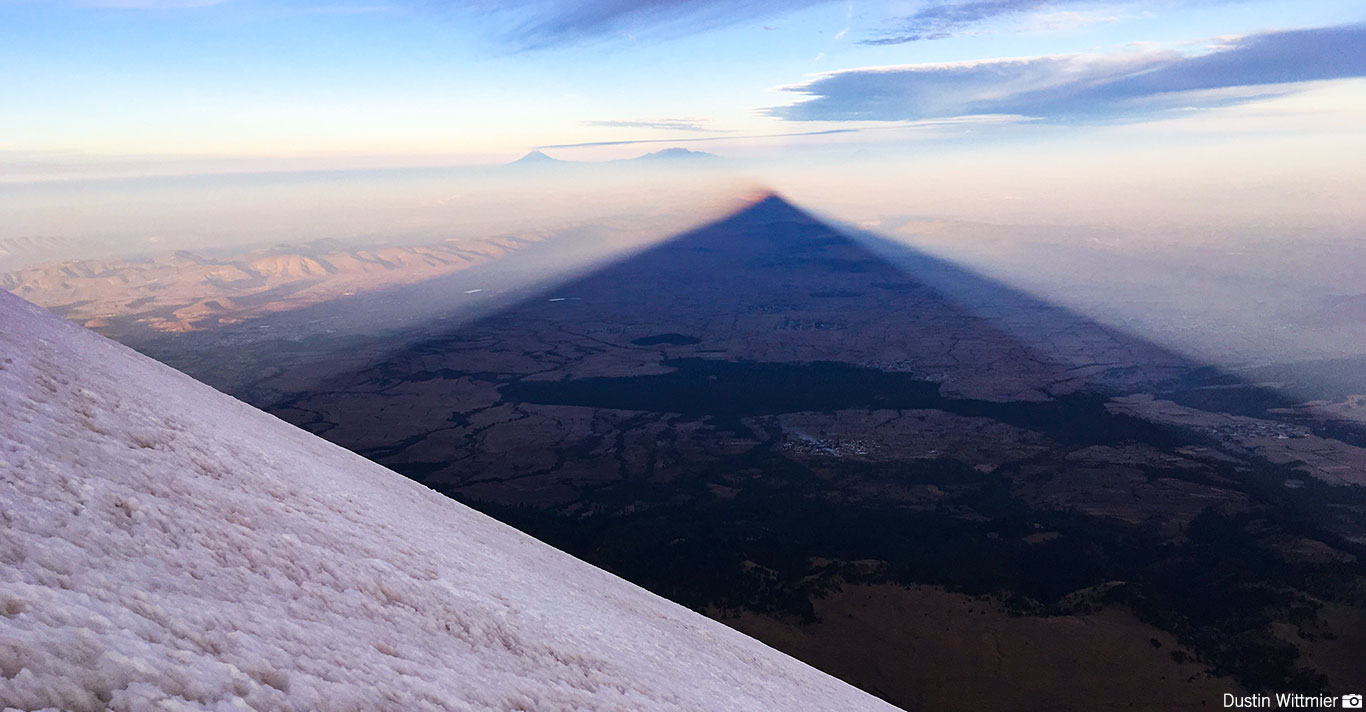 The shadow of Orizaba with Popo in the distance